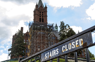 Scaffolding remains along the front of Crouse College as crews work on masonry restoration. Photo taken by July 11, 2017